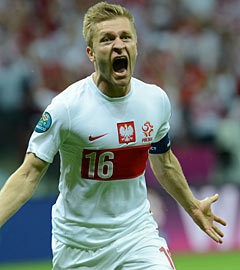 Якуб Блащиковски в матче Польша - Россия. Фото  (c)AFP