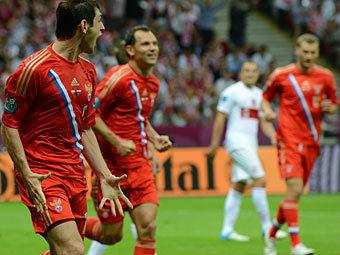 Алан Дзагоев (слева). Фото (c)AFP